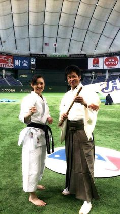 A flute instrumental and Karate demonstration highlights the pregame festivities at the Tokyo Dome during the Japan Series, Rika Usami interacting with Yasukazu Kano famous bamboo flute.