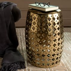 This decorative garden stool gives any decor a touch of Moroccan flair.