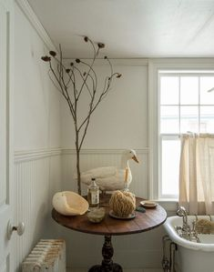 Bathroom of the Week: John Derian's Homage to Cape Cod (Remodelista: Sourcebook for the Considered Home) Home Interior, Interior And Exterior, Interior Decorating, Decorating Ideas, Cape Cod Bathroom, Master Bathroom, Bathroom Table, Bathroom Fixtures, Nautical Bathrooms