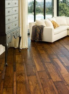 Love the different sizes of wood boards and the dark stain on this floor.