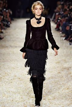 Look 25 from the TOM FORD AW15 Womenswear Collection #TOMFORD   Peplum top with scoop neckline, tiered fringe skirt, knee high beaded toe and jewel heel boot, knots choker with pendant.