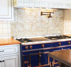 Orange lavastone counter with blue French range and Tabarka tile backsplash. | Nord 5 Kitchen Backsplash By Tabarka Studio