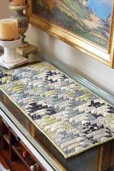 The way these fabrics play off of one another is fascinating! Coffee Table Poetry, by Diane Tomlinson, is a table quilt pattern with personality. We love this one!
