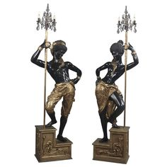 Pair of Italian Blackamoor Figures | From a unique collection of antique and modern candleholders and candelabra at https://www.1stdibs.com/furniture/lighting/candleholders-candelabra/