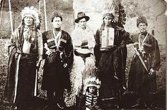 Two Oglala men (far left and 2nd from the right) and a baby, with other members of Buffalo Bill's Wild West Show - circa 1889