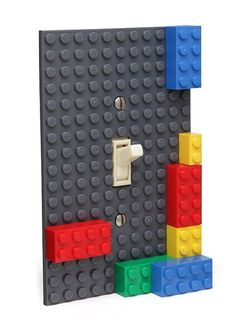 Building Brick (Lego) Light Switch Plate #Lego - Geek Decor <------ I would put this in a guest room and when they leave the room to go to the washroom or something I would turn it on and build a box around the switch so they can't turn it off without like breaking their nails. Preferably at night so they can't turn it off to fall asleep *maniacal laugh*
