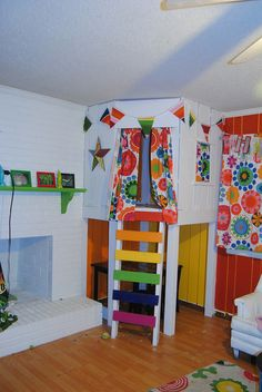 A Star Wars, Doctor Who, and Harry Potter rainbow living room with a kids nook   Offbeat Families