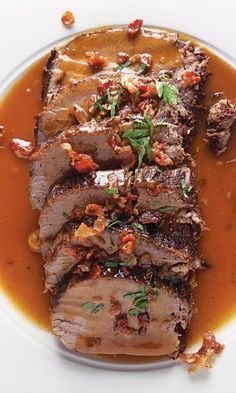 German Pot Roast (Sauerbraten) Just a touch of sugar gilds the gravy in this traditional German sauerbraten, balancing both the pickling spice and notes of sour lemon. Roast Recipes, Entree Recipes, Game Recipes, Recipies, Chicken Recipes, German Sauerbraten Recipe, Sauerbraten Recipe Slow Cooker, German Pot Roast Recipe, Beef Dishes