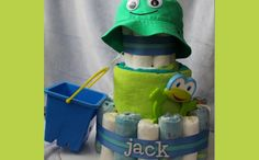 Beach Baby Diaper Cake Made with diapers, beach towel, infant sun hat, teether, and baby's first sand bucket, this beach-themed diaper cake ...