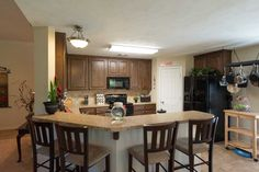 Open to the dining area and living room, the bright and airy kitchen features an eating bar and plenty of room to create your next culinary masterpiece!