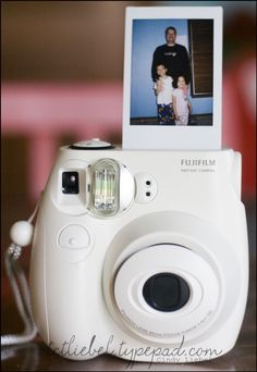"Mini ""polaroid"" (aka instant flim) camera that makes pictures the size of credit cards (fujifilm instax mini 7s white instant film camera).  Cute idea."