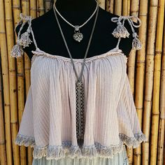 Free People Serenity Gauze Tie Top NWOT Free People SerenityGauze Tie Top with Fringe trim. So cute! SOLD OUT Color is Lilac Gray also named Serenity as one of springs hottest colors! Super cute!!! NWOT  ✔Poshmark Compliant Closet No Trades  No Outside Transactions  ❔ Please Ask Any Questions BEFORE You Buy    USE THE OFFER BUTTON TO MAKE AN OFFER     Thank you for stopping by!             Happy Poshing Free People Tops Crop Tops