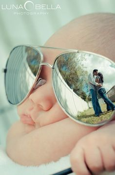 I am not sure which is cuter, a baby in rays or the cool reflection angel for the family portrait.  Super neat!!