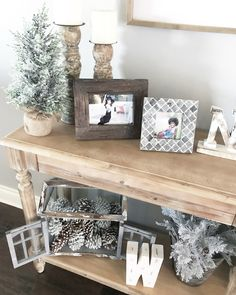 Neutral Christmas decor ideas for an entry way and console table.