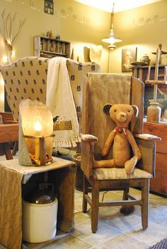 Love the old teddy bear in the antique chair.