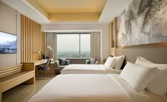 The Alila hotel group's latest opening in Solo offers an absorbing mix of modern architecture, history, dramatic landscapes, and culture. Architects Denton Corker Marshall have inserted 255 rooms into nine towers ranging from 11 to 28 storeys – sheathe...