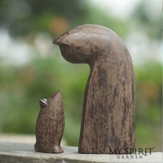 This unlikely duo depict the epitome of patience, tolerance and understanding. Their calming relationship will add a sense of unity and balance to your home. Both are carved in rich, antique finished volcanic ash and weathered for indoor or outdoor use.    Materials: Crushed basalt and cement Finish: Antique Weatherproofed Rubberized base Dimensions: Cat:  3in W x 6in D x 10in H Mouse: 2in W x 3in D x 5in H