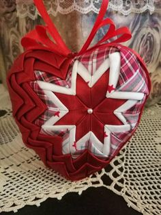 Beautiful quilted heart ornament to accentuate your home decor. I crafted this heart with great attention to detail in a smoke free / pet free environment, using high quality satin and cotton fabric. Size: Folded fabric on a Styrofoam 11cm heart (4.33 inches). Two variations