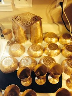 Dollar store bowls and cups spray painted gold for arabian knights birthday party