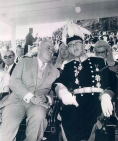 """""""1964 Changeover: In Nassau Sir Roland T. Symonette, left, first Premier of the Bahamas, chatted with Gov. Sir Robert Stapledon as Britain gave up its rule in favour of self-government for the Bahamas."""""""