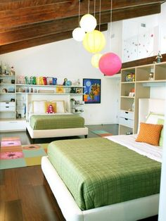 If your kids have to share a room, designate a personal space for each child. The shelving units around each of these beds provide a little buffer space, and an opportunity for each child to display their favorite things. Design by B. Pila Design Studios