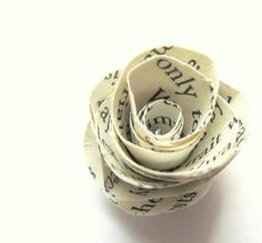 This tutorial on my blog shows you how to make an upcycled paper rose.