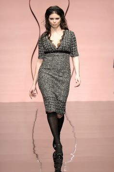 Why is this model wearing knee highs with this?  Elena Miro Fall 2006 Runway Pictures - StyleBistro