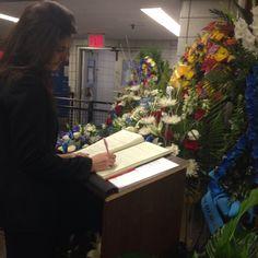 Kosovo Ambassador Vlora Citaku notes her impressions at the NYPD condolences book, Dec 24, 2014