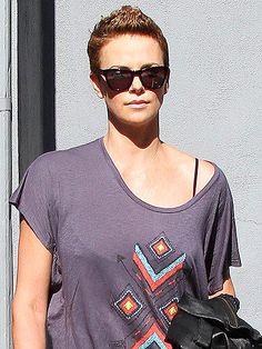 THE FEMALE FAUX HAWK  Let's hear it for the boy's ... inspired mane. Charlize Theron gives her supershort crop a playful lift and makes at least a few editors here momentarily consider chopping off their long locks.