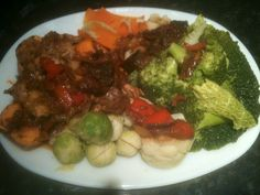The ultimate healthy dinner today!,broccoli,savoy cabbage,cauliflower,brussels,carrots,sweet potatoes,and chicken breast sliced and simmered in a South African Pinotage red wine.with mushrooms,red onions,garlic,tomato purée,tomato,sunripened tomatoes,oregano,basil,smoked paprika,cayenne pepper,red pepper,salt and black pepper. Yummy!!