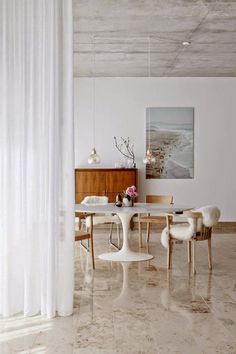 Office space inspiration - dining / work space all in one, curtain to divide the spaces. Clean lines from the wood chairs.