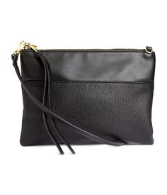 Small shoulder bag in grained imitation leather with a detachable shoulder strap, zip at top, and an inner compartment with zip. Lined. Size 6 1/4 x 8 1/2 in.