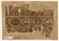 This small tapestry-woven fragment reveals the degree of continuity between the Coptic and Fatamid textile production in Egypt. Stylized scr...