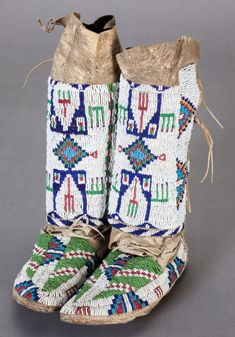 American Indian Art:Beadwork and Quillwork, A PAIR OF SIOUX GIRL'S BEADED HIDE LEGGINGS / MOCCASINS. c. 1890...(Total: 2 Items) Image #1