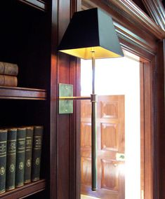 bookcase for library, the header over the door is very interesting