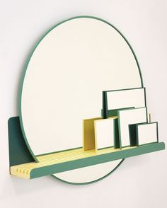 Graduate Directory 2015 | Design | Wallpaper* Magazine - Gina Heltorp Andersen's wall-mounted shelf supports an array of green-rimmed mirrors that can be arranged into different graphic compositions of overlapping geometric shapes. Called 'Pablo', the piece is named after Picasso, whose distorted paintings inspired the concept.