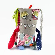 A friendly and sleepy monster full of good wishes. Lovely housewarming and Halloween gift. Plush monster is made of linen and cotton fabrics and filled with polyester fiber. Facial expressions are drawn using free motion quilting. The monster is ca 9 inches (24 cm) tall together with the
