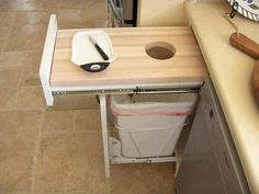 genius! a chopping board with a hole into a bin