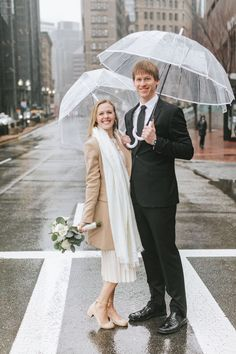 Cannolis, snow, rings, oh my! This winter wedding at Boston City Hall was simply perfect. The bride wore a knee-length lace dress and camel peacoat, the groom rocked a black suit, and they shared a cute clear umbrella to hide from the rain and snow! To warm up, they shared limoncello and cannolis at Caffe Vittoria in the North End of Boston. Rain, shine, wind, snow, Boston is the BEST place to elope! Check out more of Lena Mirisola's epic city elopements. Boston City Hall, Clear Umbrella, Lace Dress, White Dress, City Hall Wedding, Courthouse Wedding, Wedding Moments, Beautiful Couple, Photography Ideas