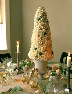 DIY ~ Yuletide Topiary Using carnations to evoke a snow-covered tree, this centerpiece transforms the tabletop into a fanciful winter garden. Beautiful Christmas, White Christmas, Christmas Holidays, Christmas Crafts, Xmas, Unique Christmas Decorations, Christmas Table Settings, Gold Decorations, Wedding Decorations
