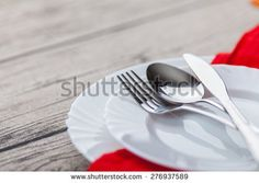 Plates and cutlery on wooden table - stock photo Forks And Spoons, Wooden Tables, Cutlery, Royalty Free Stock Photos, Plates, Tableware, Image, Wood Tables, Licence Plates