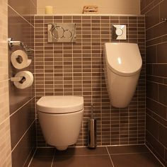 Toilet and urinal very modern want for my toilets in my home to have a urinal in every bathroom and a bidet in every bathroom
