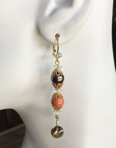 A personal favorite from my Etsy shop https://www.etsy.com/listing/535303697/coral-and-brown-pearl-drop-earrings