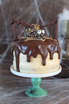 Chocolate and Peanut Butter Swirl Halloween Cake Chocolate peanut butter swirl halloween cake with a giant spider decoration! The post Chocolate and Peanut Butter Swirl Halloween Cake appeared first on Halloween Cake. Halloween Desserts, Halloween Torte, Pasteles Halloween, Bolo Halloween, Halloween Goodies, Halloween Food For Party, Halloween Treats, Halloween Spider, Halloween Chocolate