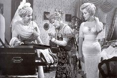 """Marilyn Monroe with Sybil Thorndike and Margot Lister in a scene from """"The Prince And The Showgirl"""", 1956."""