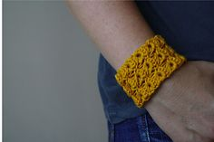 This cute cuff will give you a reason to try the broomstick crochet technique - it is not too difficult and make a cute accessory.