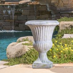 With the 22.5-inch White with Green Moss Ulysses Urn Planter you have versatility for indoor or outdoor use while still maintaining the classic style of your urn planter.