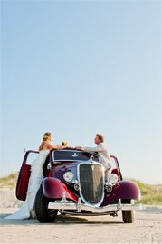 This real wedding couple's wedding was topped with a vintage get-away car at the Outer Banks! Daniel Pullen Photography http://www.outerbanksweddingassoc.org/membersearch/memberpage.html?MID=1847=Photographers=16