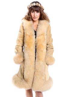 Hello, Ms. Penny Lane! There are no words for how FAB this coat is. It hangs, it drapes, ever so rad-ly. We dare you to not look COOL in this coat. (We are) OBSESSED. Real Fur. Circa 1970. Details: *