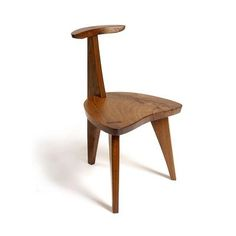 Nakashimas 'Concordia chair' - note how the separate pieces of wood for the seat are tied together using butterflies.